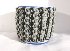 Hand knitted striped black and grey cup cozy with black button