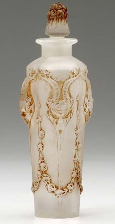 "RENE LALIQUE ""Pan"" Perfume Bottle Of Clear And Frosted Glass With Sepia Patina c1920......."