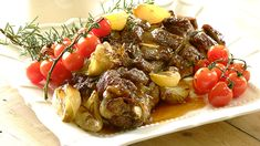 ROAST SHOULDER OF LAMB WITH GARLIC AND TOMATOES - A delicious shoulder of lamb with baby onions, garlic, cherry tomatoes and fresh herbs!