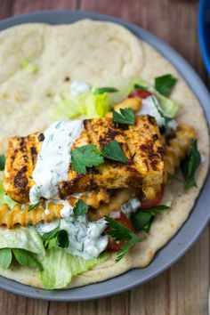 Grilled tofu gyros recipe, made by seasoning tofu in a Greek-inspired marinade and grilling it to perfection, served with dairy-free tzatziki and pita.