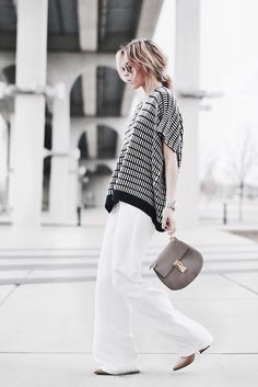 spring / summer - street chic style - beach style - business casual - office wear - work outfit - nude pumps + grey crossbody bag + black and white pattern oversized sweater + white wide leg pants + sunglasses