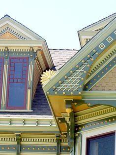 Close up of fantastically decorated and painted Victorian house features.  Great use of colors - blue-gray, purple, gold, white.  Would love to see whole house!