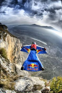 "Wingsuit gliding... singing, ""I believe I can fly"" :)"
