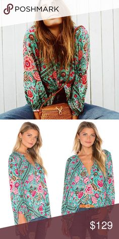 Spell Designs Turquoise Babushka Blouse A stunning, relaxed fit, button down blouse in this gorgeous original Babushka print. This Spell and the Gypsy blouse is the perfect colour pop to tuck into vintage denim, under overalls or belted and worn with a Spell skirt or shorts in a clashing print! Spell & The Gypsy Collective Tops Blouses