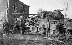 Destroyed German Panther tank in Hotton, Belgium.  The other tank looks like a German tank as well.