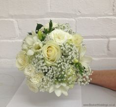 All White Wedding Flowers Theme Hand Tied Bridesmaid Bouquet with Roses, Spray Roses, Freesia and Gypsophila   Wedding Flowers Liverpool - Specialist Bridal Florist   Flower Delivery Liverpool - Same Day Delivery option   Florist Liverpool   Flower & Gift Shop Liverpool