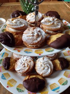 Homemade Viennese Whirls with vanilla buttercream and raspberry coulis, and some dipped in dark chocolate