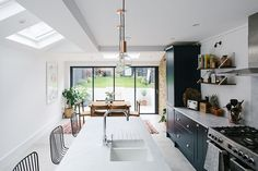 London Side Return Extension Kitchen - Image By Adam Crohill A London Victorian terrace with side return extension, mid-century style furniture and modern accents Home Decor Kitchen, Home Kitchens, Kitchen Furniture, Kitchen Ideas, Furniture Layout, Bedroom Furniture, Furniture Arrangement, Design Kitchen, Kitchen Interior