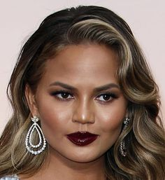 Was Chrissy Teigen channeling Lorde at The Oscars 2015 with her goth-chic lips? Click to see more of the best beauty looks from the 87th Academy Awards. (Photo: Noel West for The New York Times)