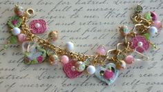 Heart Charm Bracelet .. some hearts are painted using Iced Enamels .. a mixture of glass beads and pink charms .. chain is gold and is 2 different styles .. FOR SALE $45.00 .. https://www.facebook.com/media/set/?set=a.236506493074535.58690.231939453531239&type=3&uploaded=1#!/JewelsByJann