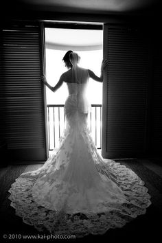 I love the dramatic photo of the bride's silhouette and the window in the room at Turtle Bay Resort. Spacious rooms at Turtle Bay Resort make it comfortable for the bride and her bridesmaids to get ready in the room. Photo by Kai Photo www.kai-photo.com. Wedding planned by Hawaii Weddings by Tori Rogers www.hawaiianweddings.net.