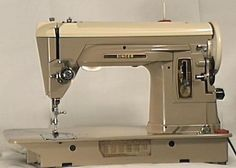 The Singer 404 Slant-o-matic (slant needle, straight stitch only) machine.  I would love to own  one of these.