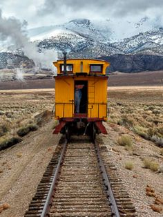 Yellow Caboose - A Nevada Northern freight train rolls northbound into the Steptoe Valley on an early Sunday morning.