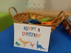 Celebrate your sons birthday with a dinosaur party. Use this cute Adopt a Dinosaur sign for the party favors. Put some plastic dinos in a bin or basket and each child can pick the one they want to adopt and take home. You can also use the sign for curbside favors during a drive-by birthday parade. Birthday Party Places, Birthday Party Games For Kids, Kids Birthday Cards, Dinosaur Birthday Party, Sons Birthday, Birthday Party Favors, Birthday Parties, Birthday Ideas, Baby Shower Game Prizes