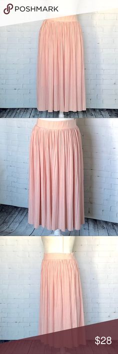 """torrid Blush Pink Pleated Midi Skirt SZ 2X Size 2, elastic waistband, great stretch Waist 18"""" Hips 22"""" interior lining  Length: 30.5"""" Condition:   EUC, tiny hole in waistband from tag- Smoke/Pet Free How I Roll: No Trades/ No offsite Monkey Business/ I Love Bundles & Offers/ Please Ask Questions if you have them!  *All measurements taken while item is laid flat and across the front.  #B17 torrid Skirts Midi"""