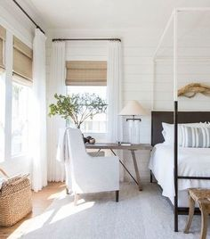 coastal bedroom decor with modern four poster bed with farmhouse bedding, farmhouse bedroom with shiplap and driftwood wall art, coastal master bedroom with woven shades, neutral airy bedroom decor with desk in bedroom, small home office in bedroom Home Decor Bedroom, Modern Bedroom, Bedroom Furniture, Bedroom Ideas, Contemporary Bedroom, Bedroom Designs, Furniture Decor, Trendy Bedroom, Natural Bedroom