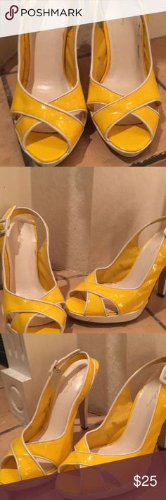 Yellow high heel sandals Yellow and white high heels. In good condition. Does have some scratches. Size 8. Where bought at Charlotte Russe. Charlotte Russe Shoes Heels