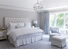 Blue and gray bedroom features a high ceiling accented with a Danville Sphere… #manchesterwarehouse