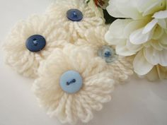 Off White Loopy Petals With Blue Buttons - yarn flowers