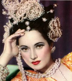 Actress Merle Oberon in exotic pearl headdress