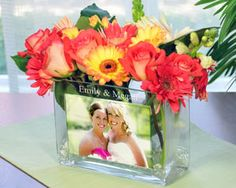 Cool idea with each table having a different picture of the bride and groom from the beginning of their relationship till the wedding date :)