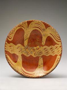Redware slip decorated plate, ca. 1770-1800.