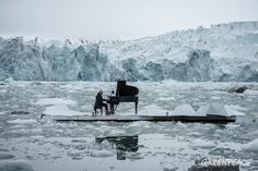 Acclaimed Italian composer and pianist Ludovico Einaudi performs one of his own compositions on a floating platform in the Arctic Ocean, in front of the Wahlenbergbreen glacier in Svalbard, Norway. 16 June 2016 © Pedro Armestre / Greenpeace