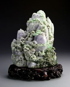 China, expertly carved jadeite landscape mountain in hues of purple and green, depicting a scene of figures on a mountain with pine trees and buildings incorporated into the cliffs, with a carved Zitan wood base. Height 11 in. Width 9 in. Chinese Culture, Chinese Art, Le Jade, Antique Jade, Jade Jewelry, Stone Carving, Gems And Minerals, Stone Art, Stone Painting