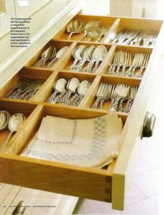 Flatware drawer with specifically sized compartments.