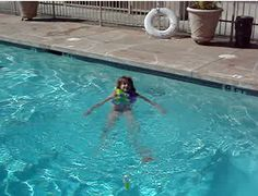 5 yr old kid in pool this was before I could swim without a vest.