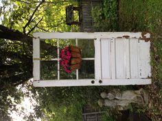 Old door with live impatients.