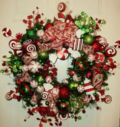 "Peppermint Candy Swirl Wreath by dardawn, a member of Etsy's ""A Handcrafted Christmas"" Team.  Visit dardawn's Etsy shop for more beautiful handcrafted wreaths.   #Christmas   #Wreaths   #Handcrafted"