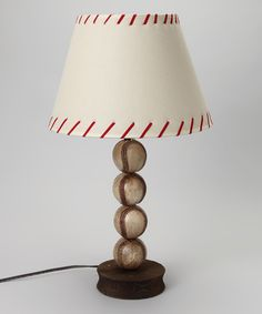 Score a decorating home run with this charming baseball lamp that honors a small slugger's favorite sport. It's perfect as a bedside light for reading biographies on the sport's greatest players before drifting off to dreamland.