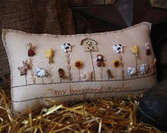 This winter-themed hand-made muslin needlework pillow is perfect for winter decor and fans of snow and the cold! Size is approximately 12.5 x 8.