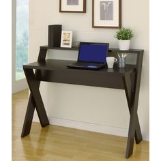 This home or office desk has a rich cappuccino-finish that will look great in a modern office space. It has a primary desk that's good for a laptop or desktop computer and a secondary shelf for extra items like ornaments, plants or photos.