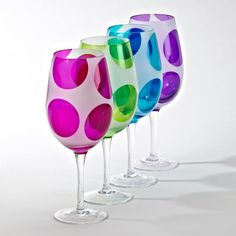 These hip new all-purpose glass goblets can be filled with fun or  whatever else you choose to use them for. A full 8.5 tall with large  colorful polka dots decorating the frosted glass bowls, and clear glass  stems and bases. They come in 4 colors pink, purple, blue and green,  packed 2 of each of the 4 colors in a case. 8 goblets total.