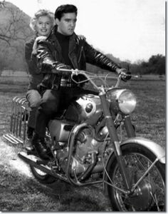 'Roustabout', When Elvi learned co-star Barbara Stanwyck never rode motorcycle, Elvis promptly hoisted the four-time Academy Award nominee aboard a motorcycle built for two and they were off in a cloud of dust.March 20, 1964, in Thousand Oaks, Calif.