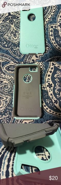 iPhone 5 otter box Used but in very good condition. The only thing wrong with it is the rubber this covers the charging port but it still closes. Teal and light gray OtterBox Accessories Phone Cases