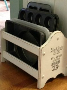 A bit of chalk paint turned a magazine rack into a shabby-chic place for pans that's totally worthy of a spot on a countertop.