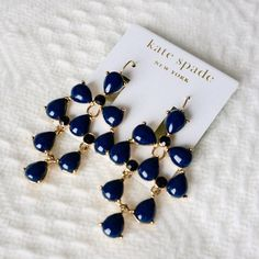 NWT Kate Spade navy and black earrings Ultra chic Kate Spade earrings, new with tags. The smaller stones are black, while the larger stones are a pretty navy color. Perfect to accentuate a sweater or cute dress. kate spade Jewelry Earrings