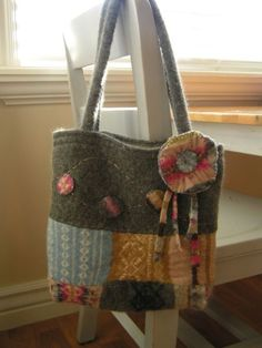 I made this purse out of an old sweater that I bought from a second hand store. I turned the sweater into felt. I didn't follow any plan, I just cut it up and sewed it together into a...