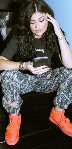Kylie Jenner: Shirt – Yeezus  Pants – Supreme  Bracelet – Cartier  Shoes – Nike Yeezy
