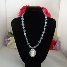 15% off 40617 Blue & White Beaded Chain with a Cameo Pendant Set in Silvertone and hanging from a Round Blue Beaded Necklace Free Shipping to the United States.