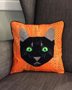 Boo, the black cat, is lounging comfortably in his favorite chair this afternoon. Halloween Pillows, Halloween Quilts, Halloween 1, Cat Fabric, Fabric Yarn, Quilt Stitching, Applique Quilts, Pillow Pals, Snowman Quilt