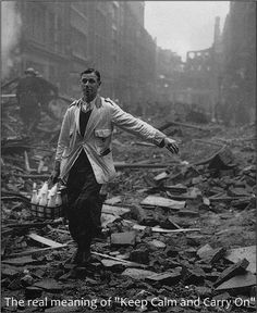 """""""Keep calm and carry on"""":  a milkman continues his rounds after an air attack, London, 1940."""