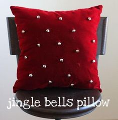 Jingle bell pillow So cute - She has some other ideas for dressing of throw pillows for the Christmas holidays. The neat thing is the ideas can be used for different seasons of the year. And they are all really easy - store bought pillows and you apply t Decoration Christmas, Xmas Decorations, Diy Decoration, Sewing Pillows, Diy Pillows, Throw Pillows, Decorative Pillows, All Things Christmas, Christmas Holidays