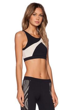 http://www.revolveclothing.es/solow-racer-sports-bra-in-black-blush/dp/SOLO-WM79/