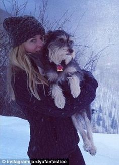 Actress Dakota Johnson with Her Dog | Looks like a Schnauzer to me! What do you think?