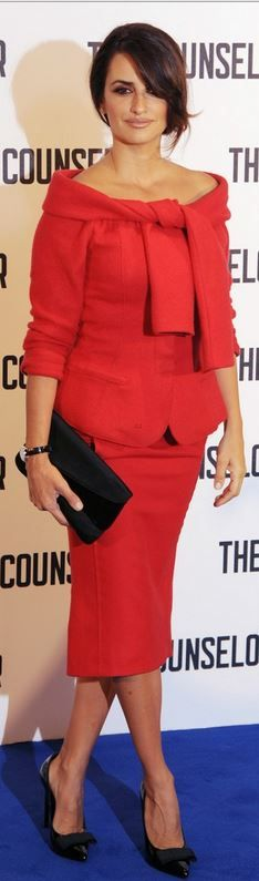 Who made  Penelope Cruz's red skirt and off the shoulder jacket that she wore in London on October 4, 2013?