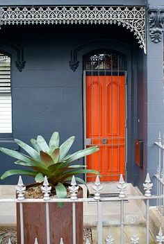 Loving the door color. Hmmm, I could do an orange door. Exterior Gray Paint, Exterior Paint Colors For House, Paint Colors For Home, Exterior Colors, Gray Siding, Grey Paint, Interior Design Blogs, Orange Front Doors, Green Doors